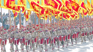 Members from Sri Lankan military march wth national flags during Sri Lanka's 68th Independence day celebrations in Colombo