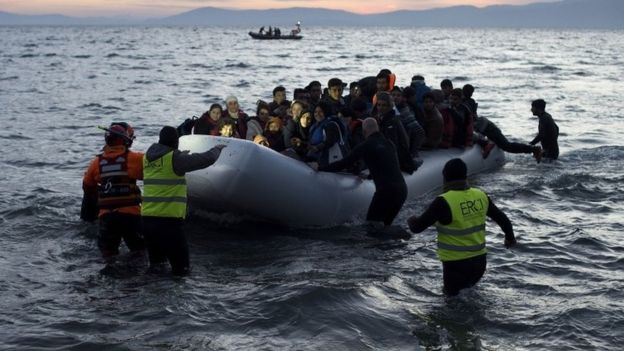 Turkish guards use sticks to hit migrant boats