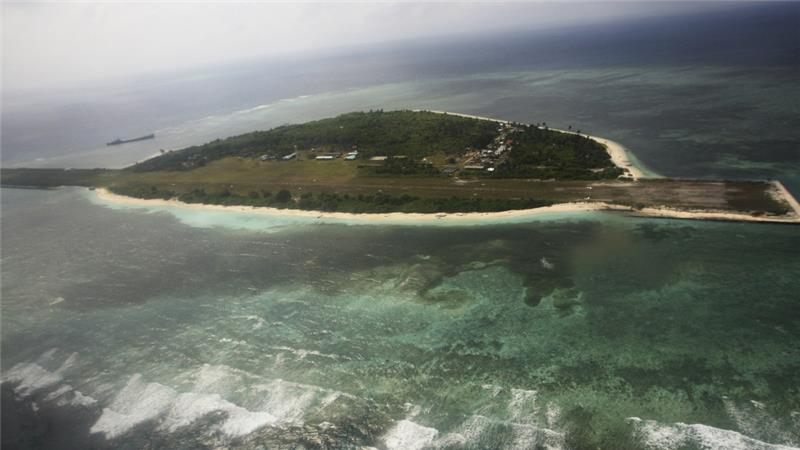 China's military plane lands on disputed Island